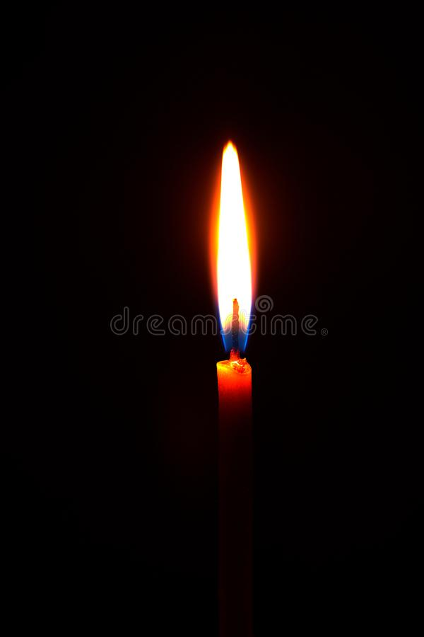 Church candle burning in the dark creates a spiritual atmosphere. A church candle burning in the dark creates a spiritual atmosphere. Hope. Prayer. sorrow, faith royalty free stock image