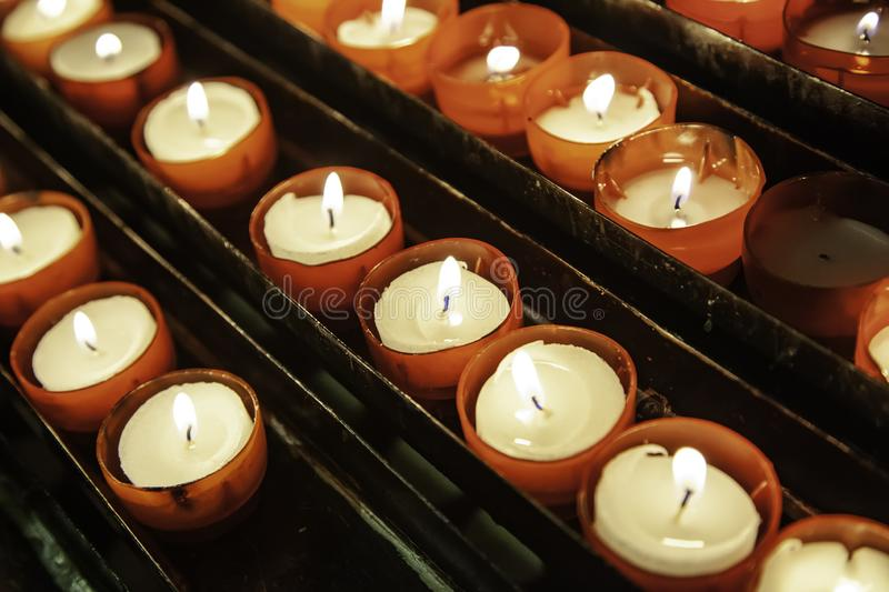 Church candles lit stock image