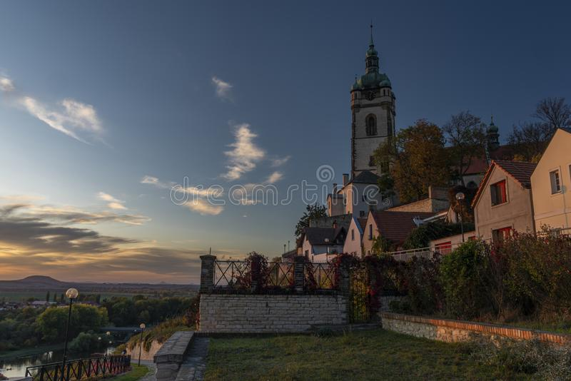 Church castle and old houses in old town Melnik in central Bohemia with sunset. Church castle and old houses in old town Melnik in central Bohemia in autumn stock photos