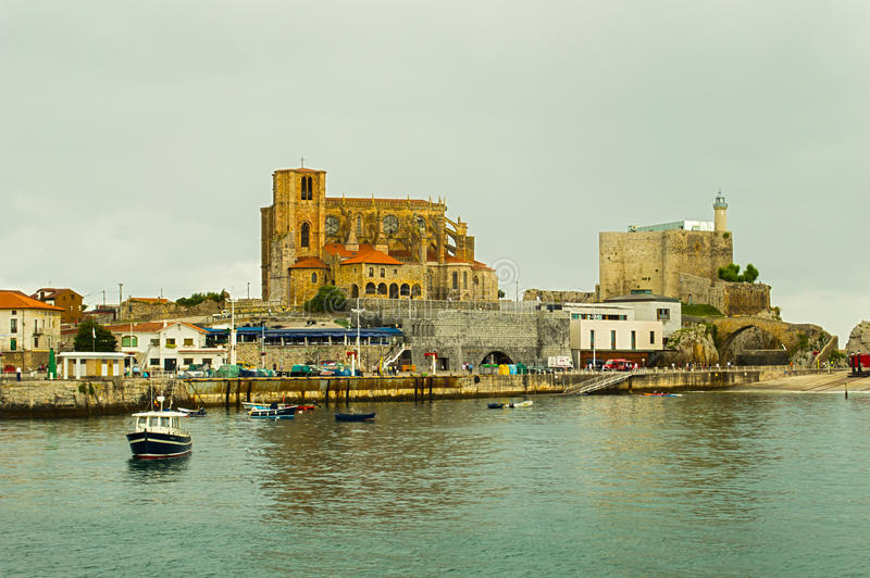 Church Of Castro Urdiales. Panoramic of Cathedral Castro Urdiales, Cantabria, Spain with marina stock photography