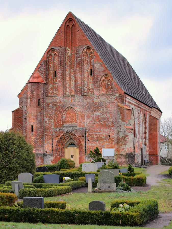 Church with cemetery in Sassen, Mecklenburg-Vorpommern, Germany royalty free stock photo