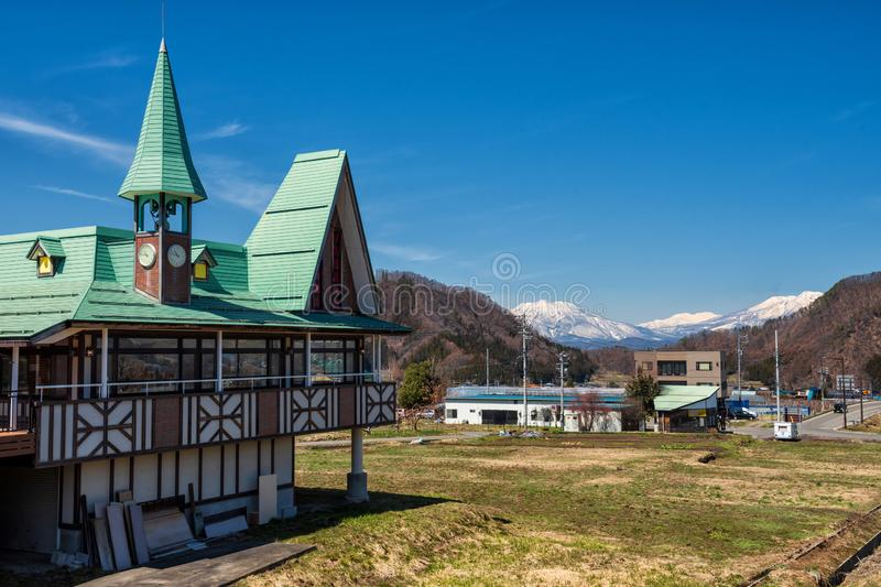 Church with central alps mountain, Yamanouchi. Beautiful church against blue sky and central alps mountain near Shibu onsen town, Yamanouchi, Nagano, Japan royalty free stock photos