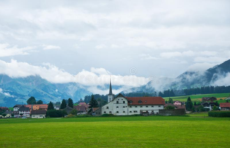 Church in Charmey village on Prealps in Gruyere Fribourg Switzerland. Church in Charmey village on Prealps mountains in Gruyere district, Canton Fribourg in stock photos