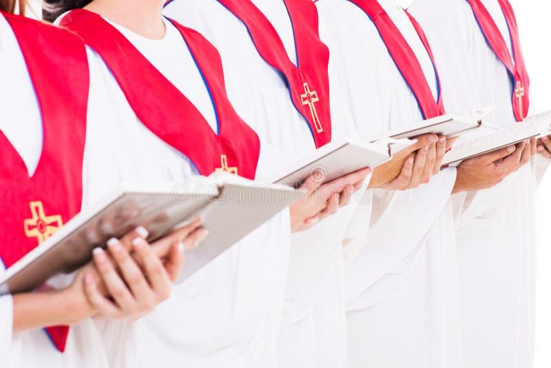 Church choir hymn books. Close up portrait of church choir holding hymn books stock photos