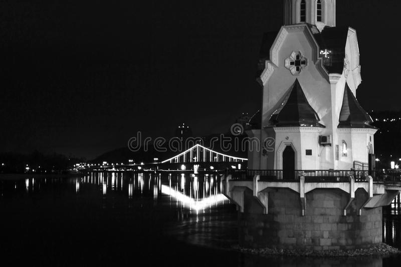 Church and cities that stand on the water at night stock photo