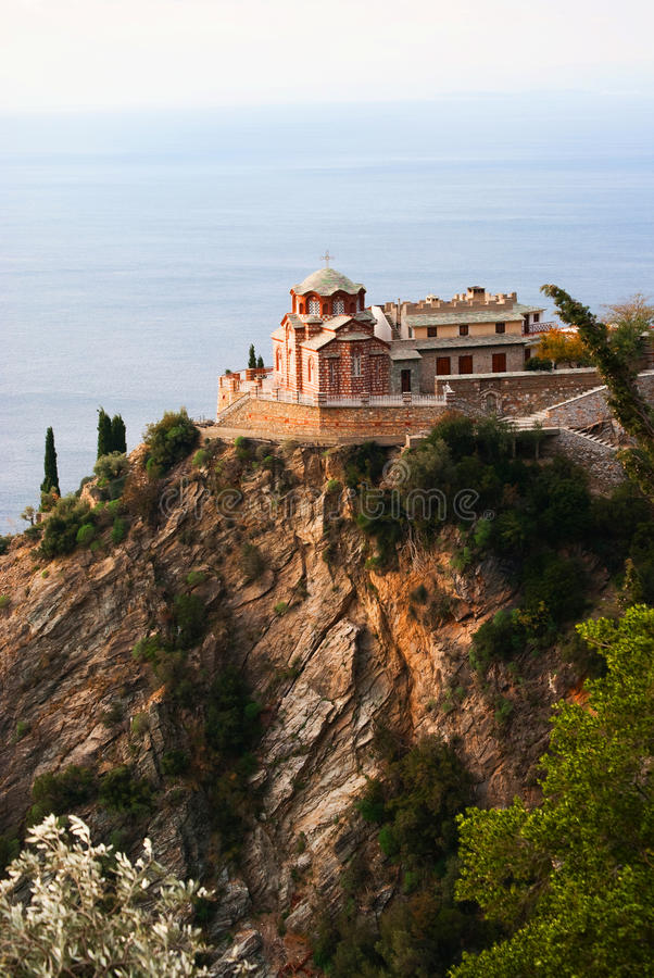 Church on a cliff. Church sitting on the edge of a cliff in Agio Oros Greece Holy Mountain royalty free stock image