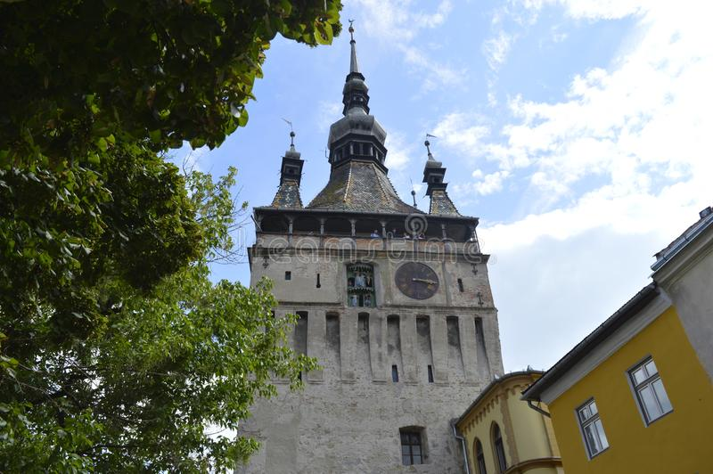 Church with clock from the Sighisoara Medieval Fortress. royalty free stock image