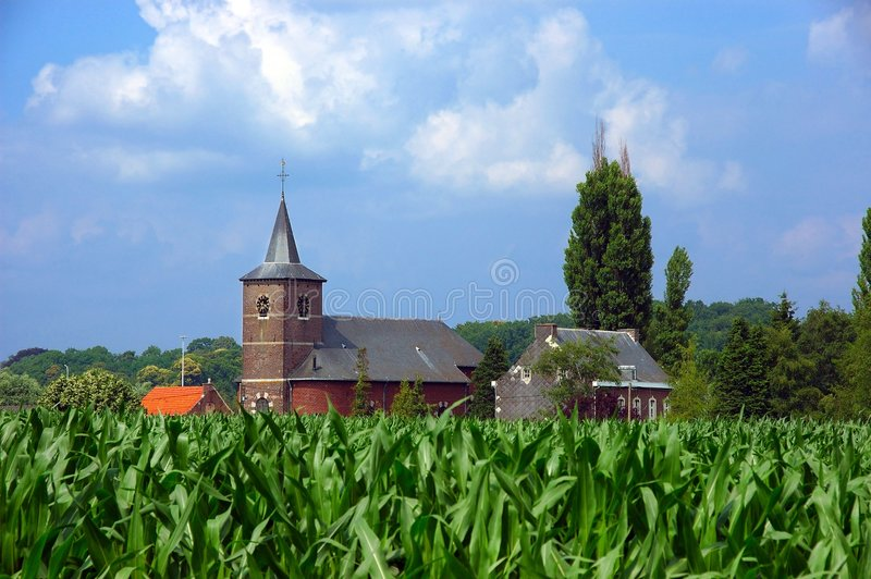 Church in corn field. royalty free stock photography