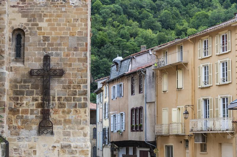 Church cross and houses in the Villa de Foix near the Pyrenees and Andorra. Ariege France.  stock photo