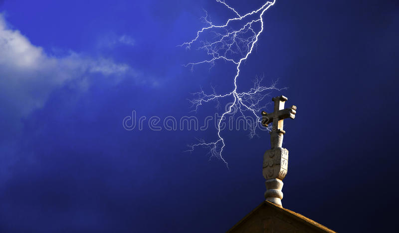 Church cross with lightning royalty free stock image