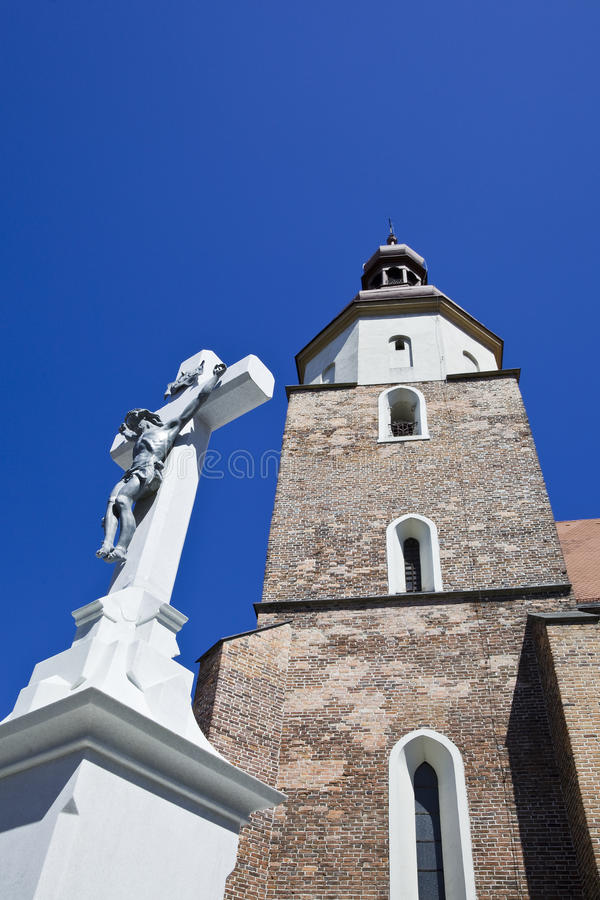 Church and the crucifix. Against blue sky stock photo