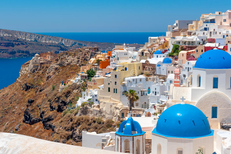 Church Cupolas and the Tower Bell from Santorini, Greece. Church domes and bell tower of Santorini,a city on a volcano , Greece stock photo