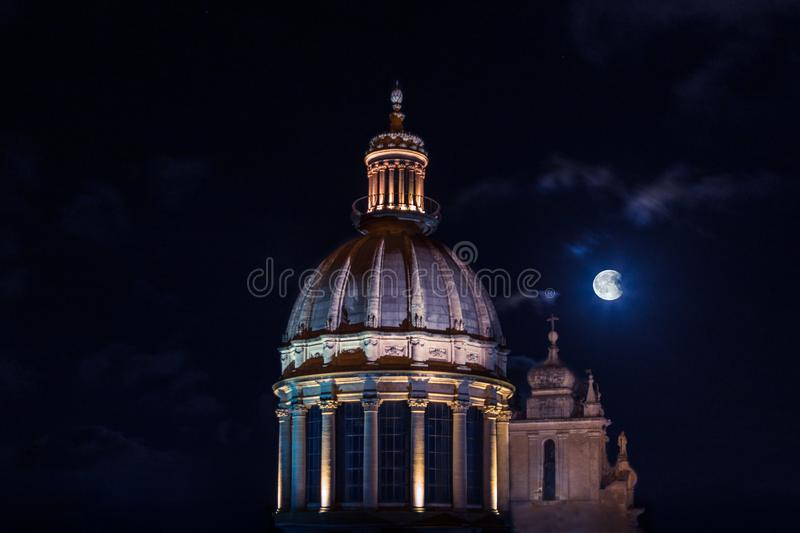 Church dome under full moon royalty free stock photography