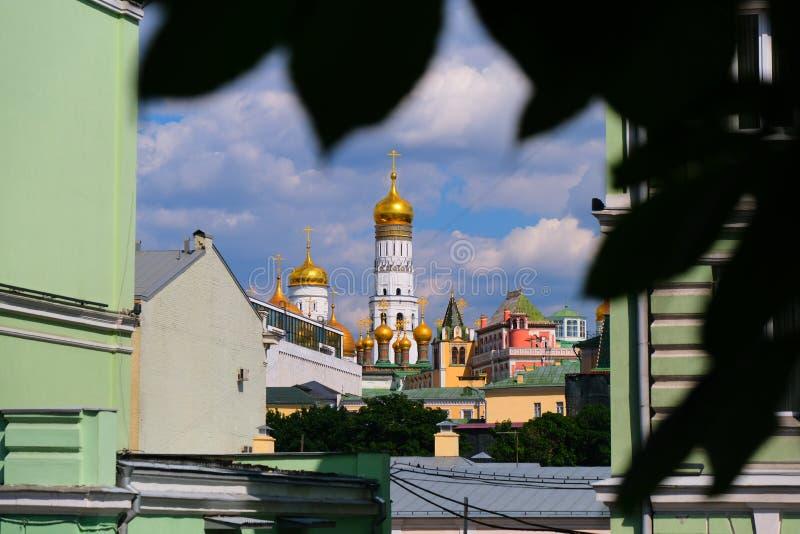 Church, domes in the city between houses. Kazakhstan, caplula, ship, alliance, cosmonauts stock photo
