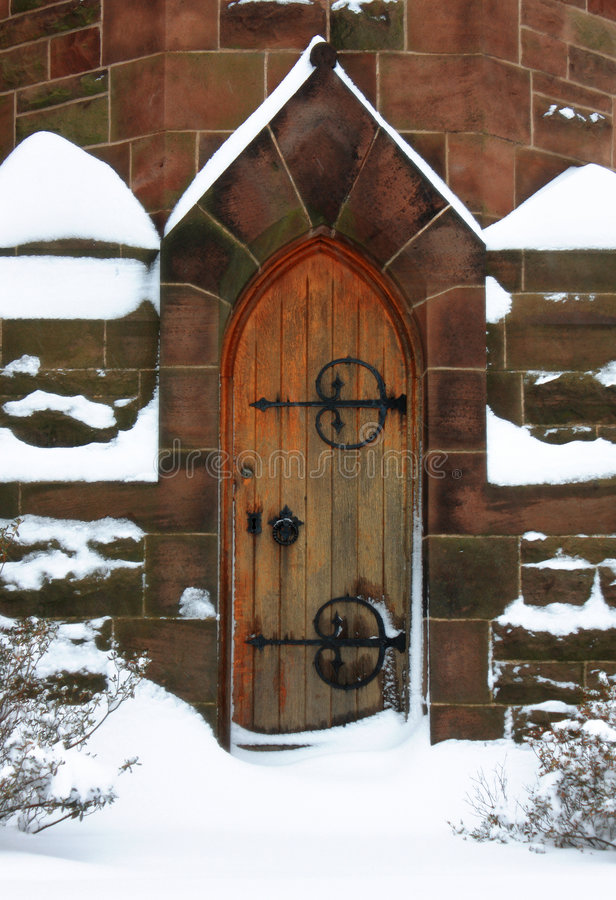 Church Door. Ornate church door in winter with snow royalty free stock images