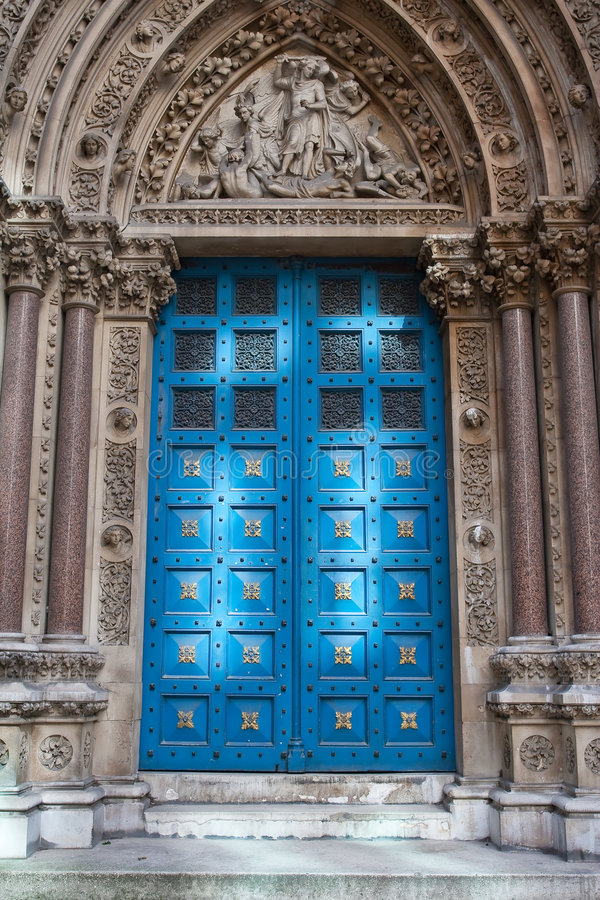 Church door. An elegant church door lighted by the reflected sunlight from the building across street royalty free stock photos