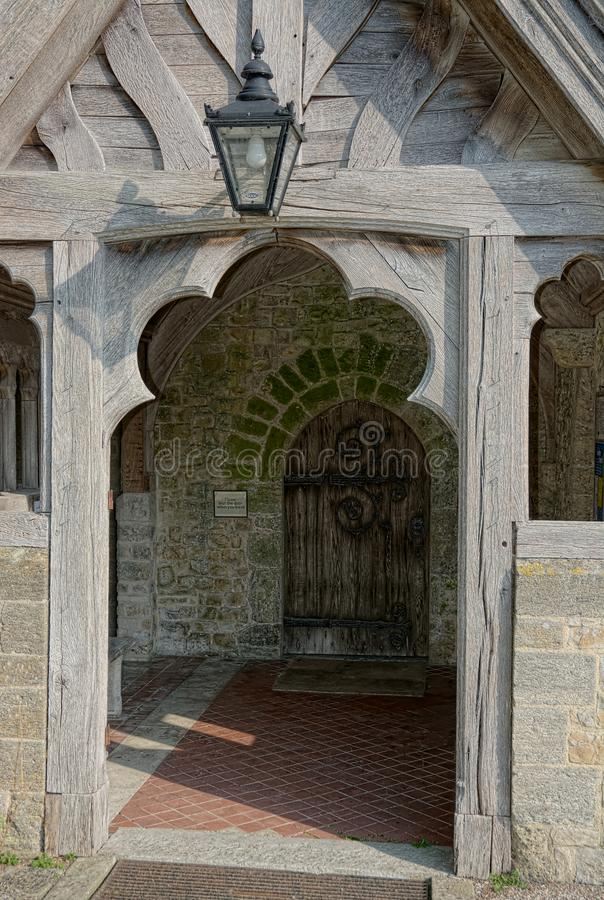 Church door & entrance. Church of The Holy Cross, Bignor, Sussex, UK. Bignor is a village and civil parish in the Chichester district of the English county of royalty free stock photo
