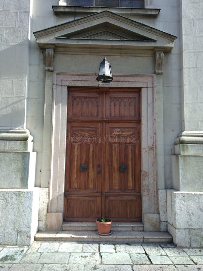 Church door with flower pot stock photo
