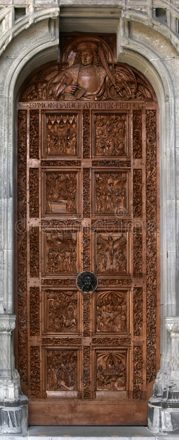Church door with wood carving stock images