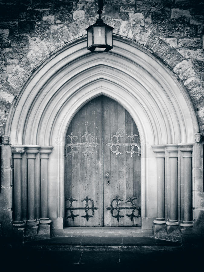 Church doorway. Church with old wooden door, and arched entrance royalty free stock photos