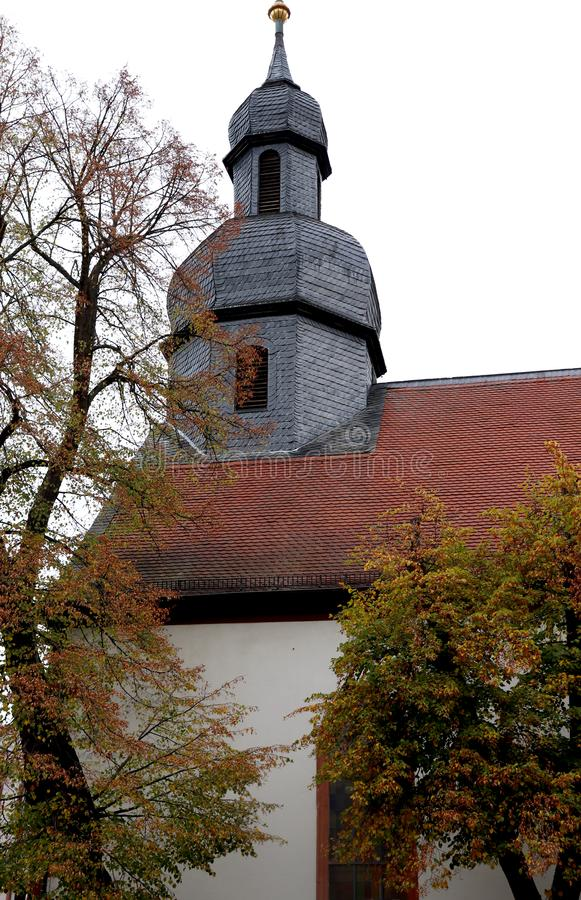 A church in downtown Kaiserslautern, Germany. With red tiles on the roof on a cold autumn day in October royalty free stock photo