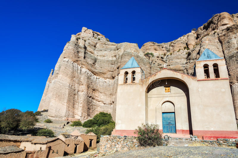 Church and Dramatic Cliffs in Bolivia. Church set in front of dramatic cliffs in Espicaya, a small town near Tupiza, Bolivia stock images