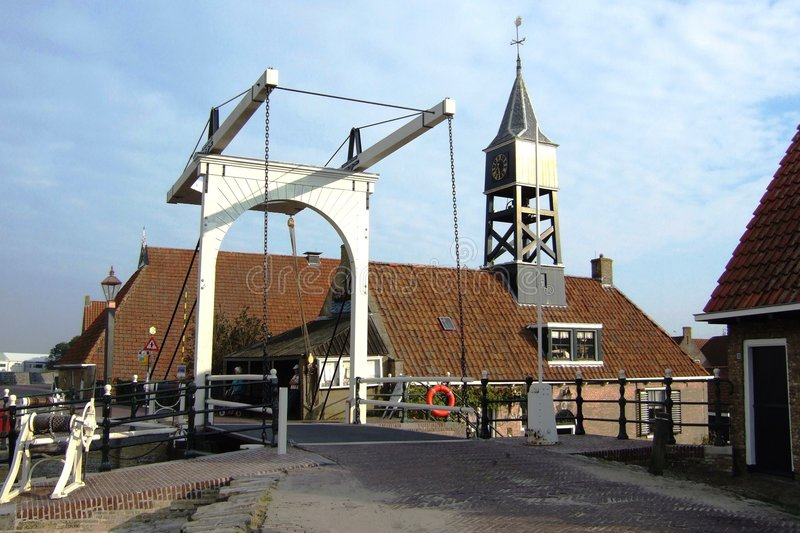 A church and a draw-bridge. A church with a bell tower with a draw-bridge in front royalty free stock images