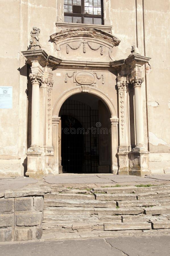 Church entrance. Church west entrance, baroque style, 18th century, in Dumbraveni, Sibiu county, Transylvania, Romania royalty free stock photography