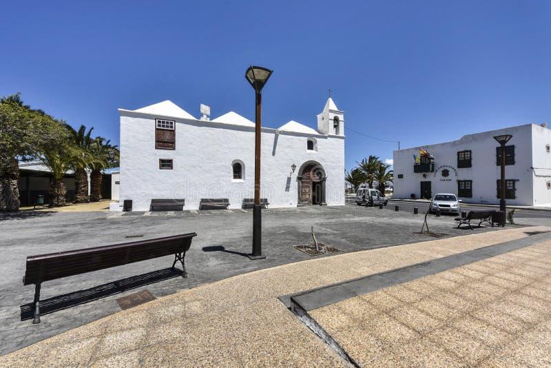 Church `Ermita de los Dolores` and town hall in spanish Casa Consistorial in Tinajo, Lanzarote, Canary Islands stock photo