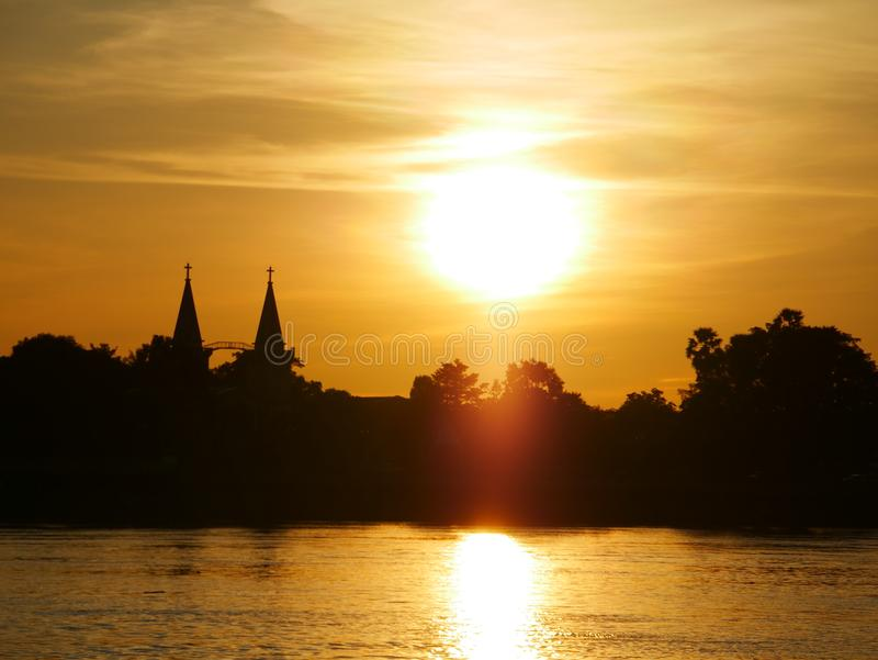 Church evening waterfront river side Mekong River. At Naklorn Phanom in Thailand royalty free stock image