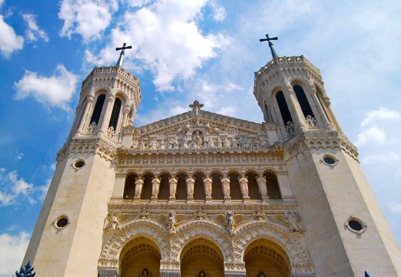 Church facade Lyon France. Exaggerated vertical tilt of church in countryside city of Lyon, France stock photo