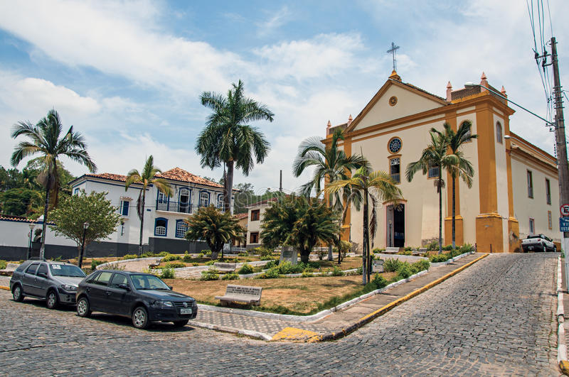 Church facade in front of the square and cobblestone street in Bananal. stock image