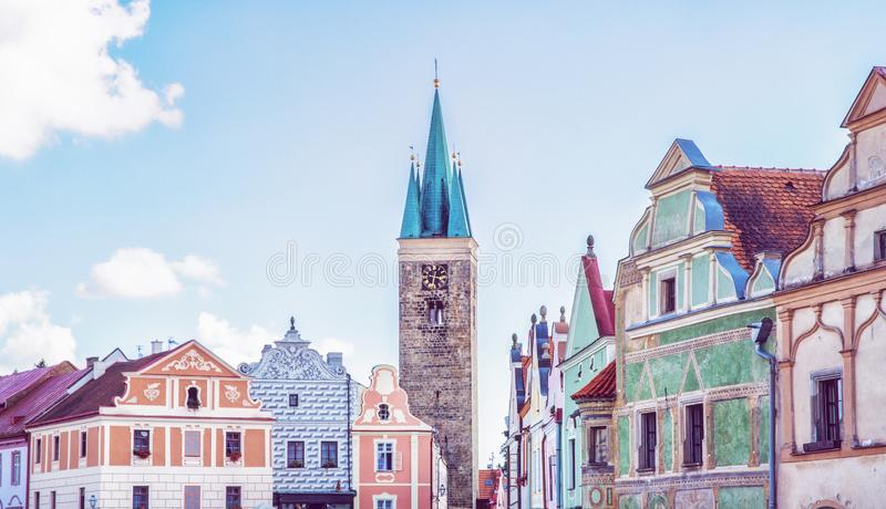 Church and famous 16th-century houses in Telc, Czech. Church of the Holy Spirit and famous 16th-century houses in Telc, Czech republic. Architectural scene stock photo