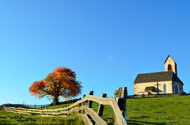 Church and fence in autumn royalty free stock image