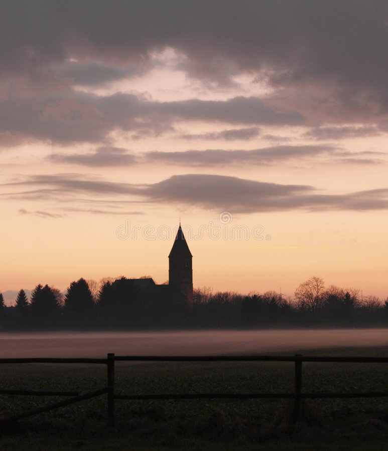 Church in the fog royalty free stock image