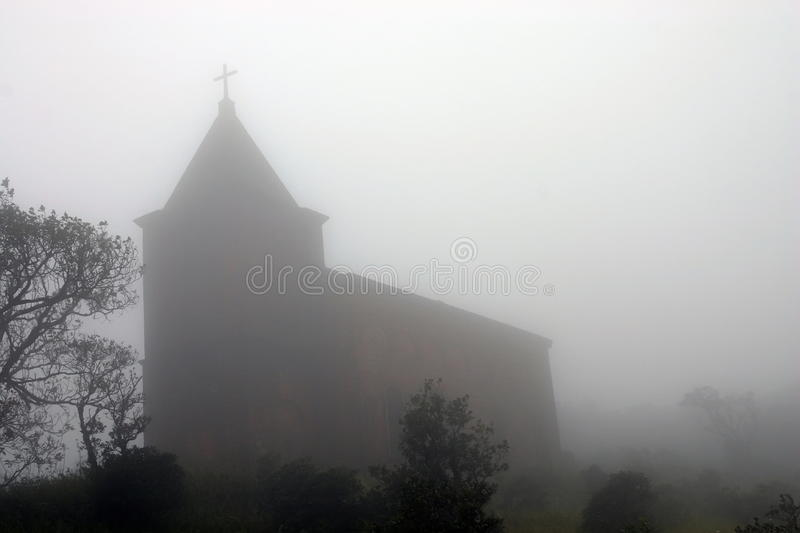 Church in fog. Bokor Hill near Kampot. Cambodia. Abandoned church in foggy weather. 'Ghost town' Bokor Hill station near town of Kampot. Cambodia stock image