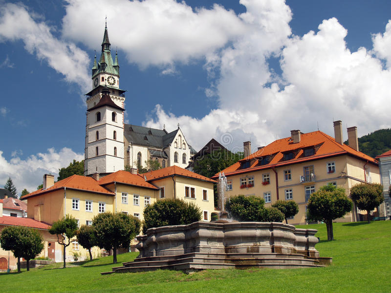 Church and fountain in Kremnica royalty free stock photos