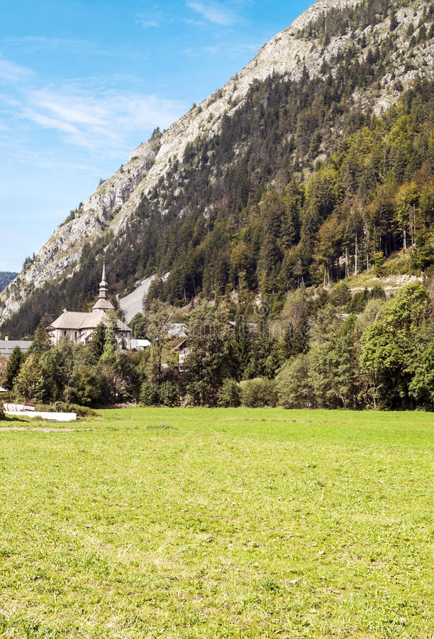 Church in the French Alps. In the valley of abundance, in the background are mountains on a sunny day, it´s a vertical picture royalty free stock images