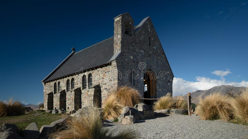 The Church of good shepherd one of the tourist attraction spot, Lake Tekapo New zealand, view from the side with afternoon sun lig. Ht and blue sky as a royalty free stock photography