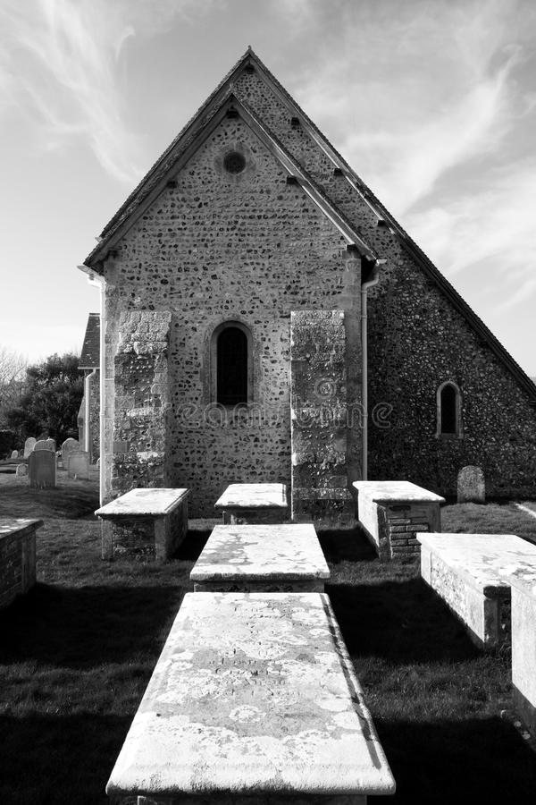 church and grave yard in Bishopstone, East Sussex, United Kingdom stock images