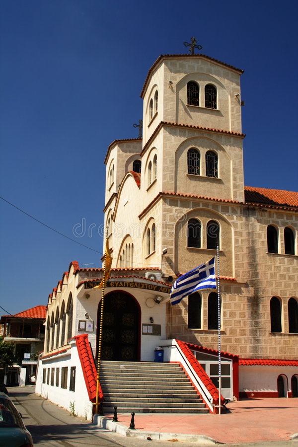 Church in Greece. Orthodox church in Greece with a greek flag royalty free stock image