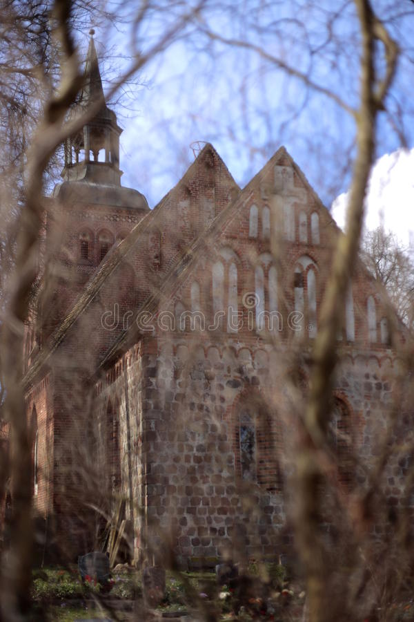 Church in Gross Kiesow, Mecklenburg-Vorpommern, Germany, with defocused foreground.  stock photography