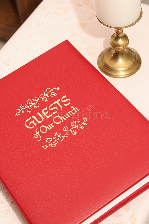 Church Guest Book 2. A red church guest book on a table, closed stock photo
