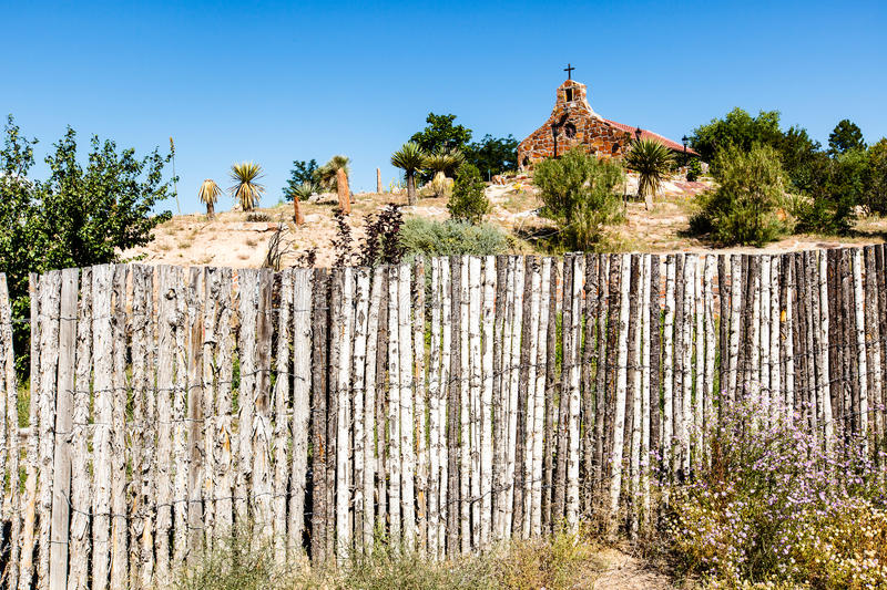 Church on Hill New Mexico. This image of a church on a hill was captured in a rural area just outside of Santa Fe, New Mexico. The grounds of the church was royalty free stock images