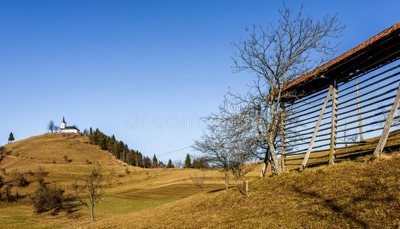 Church on a hill Sv. Jakob in Slovenia countryside. stock image