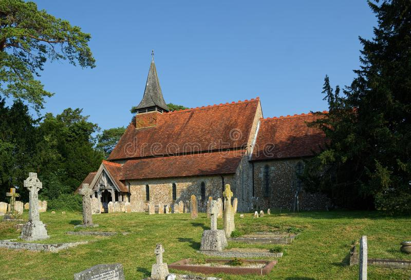 The Church of The Holy Cross, Bignor, Sussex, UK. Bignor is a village and civil parish in the Chichester district of the English county of West Sussex, about six royalty free stock photo