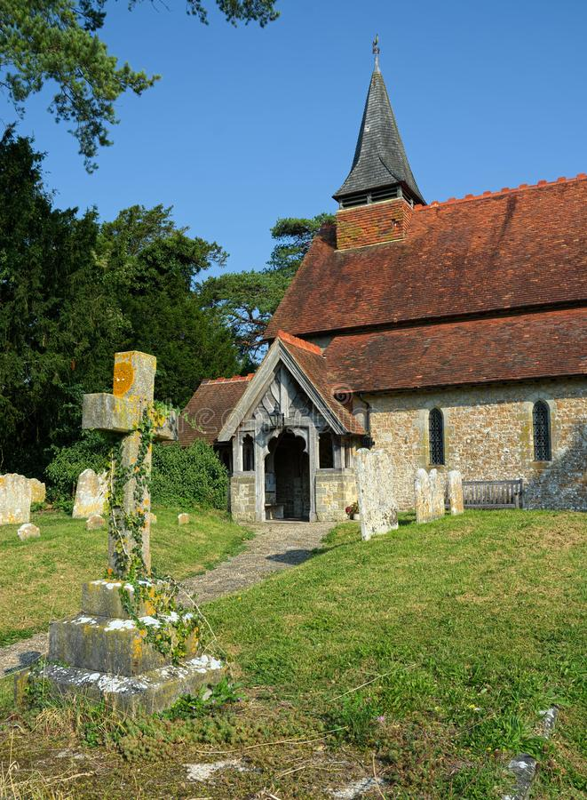 The Church of The Holy Cross, Bignor, Sussex, UK. Bignor is a village and civil parish in the Chichester district of the English county of West Sussex, about six stock photo