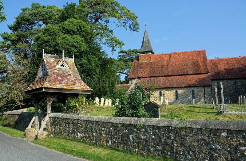 Church of The Holy Cross, Bignor, Sussex, UK. Bignor is a village and civil parish in the Chichester district of the English county of West Sussex, about six stock photo