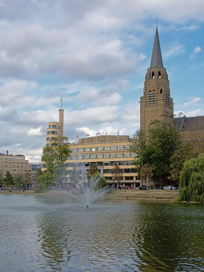 Church of the holy cross, and Flagey building aong Ixelles lakes, Brussels stock photos