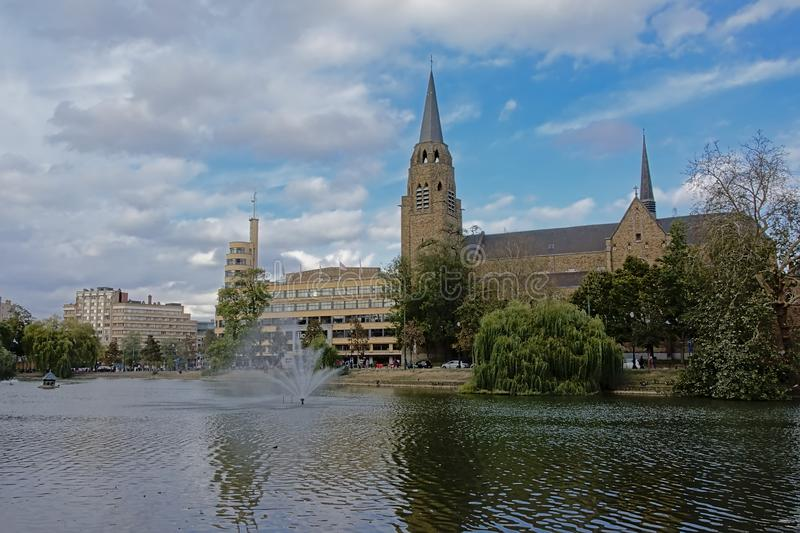 Church of the holy cross, and Flagey building along Ixelles lakes, Brussels stock images